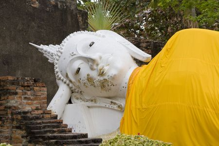 Stone statue of a Buddha in Ayutthaya, Thailand. photo