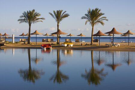 Beach on a sunny day. Hurghada city in Egypt. Stock Photo