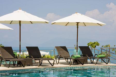 parasols: Beautiful tropical swimming pool.Thailand.