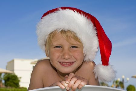 Child dressed in a Santa Claus hat Stock Photo - 6380381