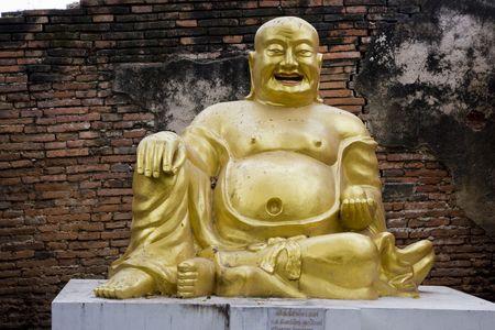 venerate: Stone statue of a Buddha in Ayutthaya, Thailand.