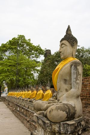 Old stone statue of a Buddha in Ayutthaya, Thailand. photo