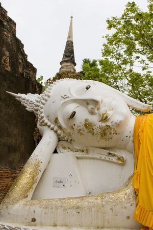 venerate: Old stone statue of a Buddha in Ayutthaya, Thailand. Stock Photo
