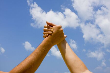 Couple hands in a sky close-up photo