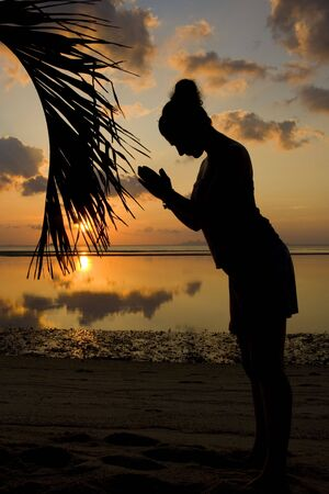 Woman silhouette with her hands raised in the sunset Stock Photo - 6605722