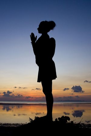 Woman silhouette in the sunset. photo