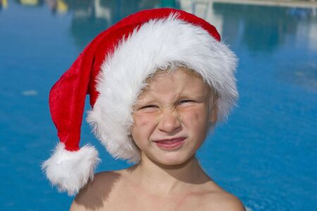 Portrait of a child wearing a hat of Santa Claus photo