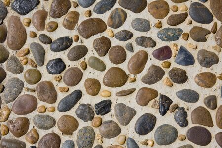 The abstract pattern of wall constructed with pebbles  photo