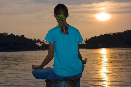 Girl doing yoga on a sunset Stock Photo - 7328369