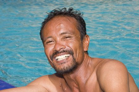 Thai man in the pool photo