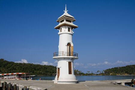 White lighthouse in bay on Koh Chang island, Thailand . Stock Photo - 7707808