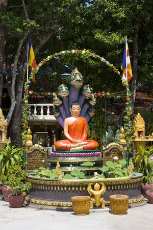 phnom phen: Images of Buddha and serpent king heads in Cambodia