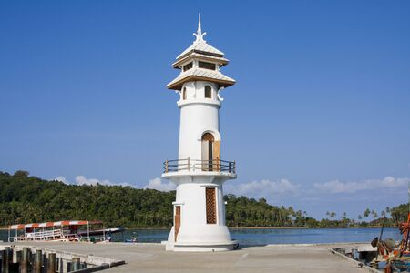 White lighthouse in bay on Koh Chang island, Thailand .  Stock Photo - 7787481