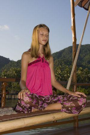 Girl doing yoga photo