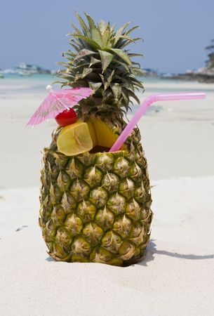 Tropical pineapple cocktail drink at the beach overlooking the ocean Stock Photo - 7787480