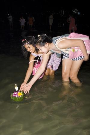 HUA HIN, THAILAND - NOVEMBER 21: Thai people with flowers. Thai people float on water a small rafts (Krathong) to celebrate the Loy Krathong festival. November 21, 2010 Hua Hin, Thailand. Stock Photo - 8226473