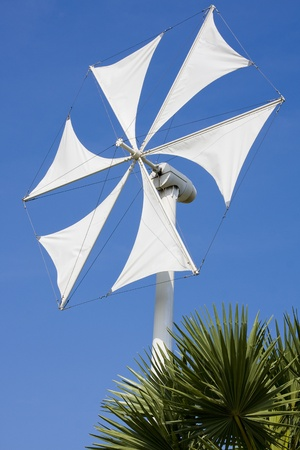 generator industry: White wind turbine generating electricity on blue sky  Stock Photo