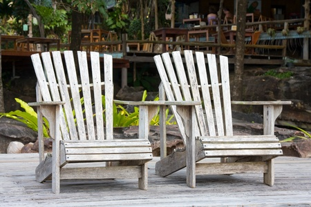 two chairs: Two chairs by the beach shore . Stock Photo