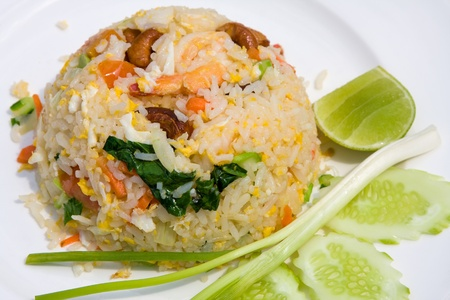 delicious seafood fried rice with shrimp, crab eggs and a light garnishing of spring onions. served with traditional sauces. Stock Photo - 9502237