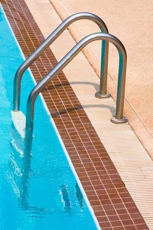 Metal ladder to swimming pool photo