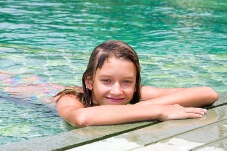 Girl by the pool smiling photo