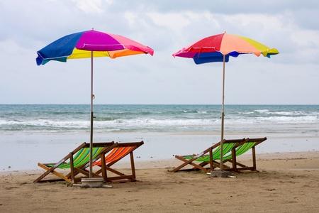 Beach chair and colorful umbrella on the beach , Thailand