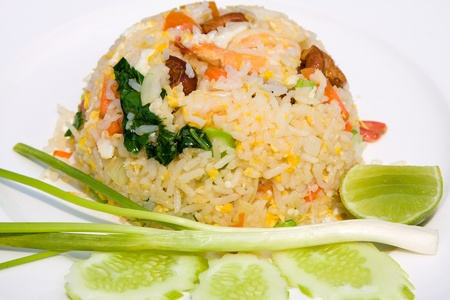 delicious seafood fried rice with shrimp, crab eggs and a light garnishing of spring onions photo