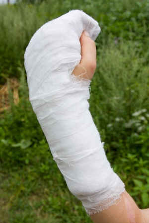 cut wrist: Bandaged hands