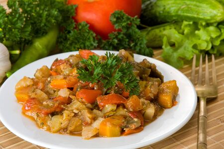 Ragout of vegetables on the white plate photo