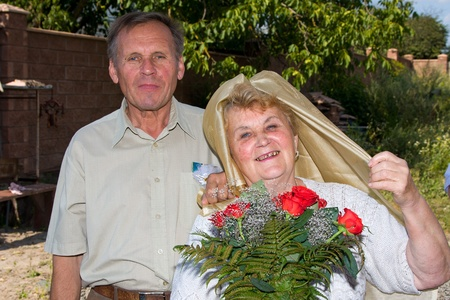 Mature couple celebrates 50th anniversary of wedding photo