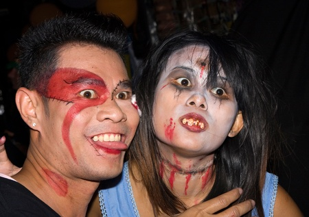 become: PATTAYA , THAILAND - OCTOBER 31 : Thai people celebrate Halloween on October 31 2010 in Pattaya, Thailand. Halloween has become popular in Thailand in recent years .