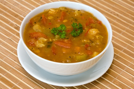 Vegetable soup on white plate Stock Photo