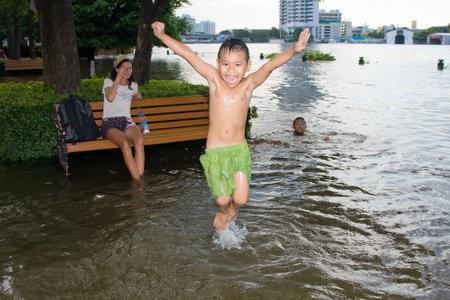 BANGKOK THAILAND - OCTOBER 25 : Flooding in Bangkok city on October 25, 2011 in Bangkok, Thailand. Water burst its banks on the Chao Phraya River to 2.5 m near the bridge Rama VIII.