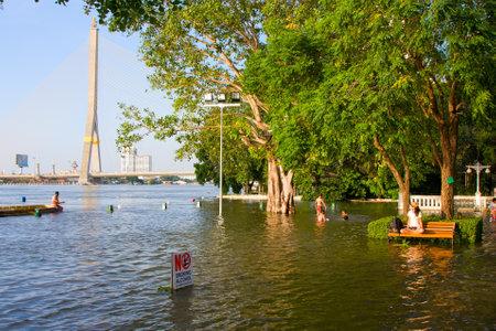 BANGKOK THAILAND - OCTOBER 26 : Flooding in Bangkok city on October 26, 2011 in Bangkok, Thailand. Water burst its banks on the Chao Phraya River to 2.5 m near the bridge Rama VIII. Stock Photo - 11044720