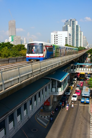 BANGKOK - OCT 25: BTS Skytrain on elevated rails above Sukhumvit Road on Oct 25, 2011 in Bangkok, Thailand. Each train of the mass transport rail network can carry over 1,000 passengers.