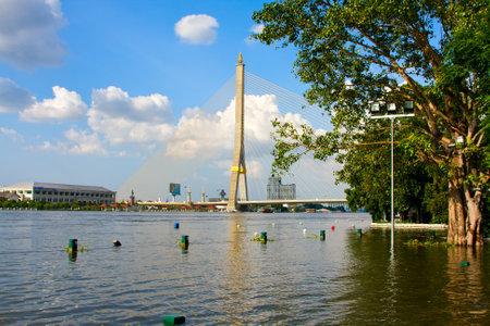 BANGKOK THAILAND - OCTOBER 25 : Flooding in Bangkok city on October 25, 2011 in Bangkok, Thailand. Water burst its banks on the Chao Phraya River to 2.5 m near the bridge Rama VIII. Stock Photo - 11201025