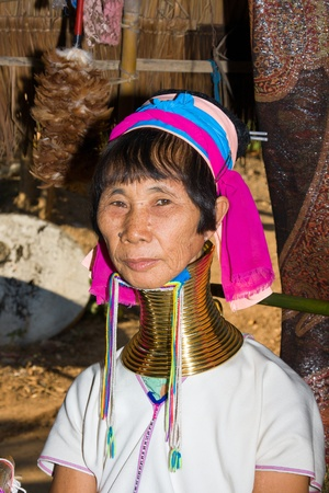 CHIANG MAI,THAILAND-November 12: Woman of the Karen tribe sitting to be watched by tourists in Nov 12, 2011 in Chiang Mai, Thailand.The Padaung-Karen long-necked tribe women are minority of Myanmar exploited for tourism reasons
