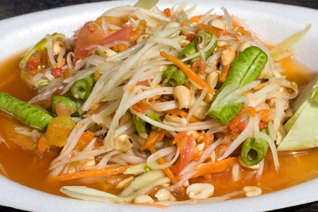 Thai papaya salad also known as Som Tam from Thailand. photo