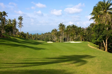 Landscape of a beautiful green golf course with sky. Island Koh Samui, Thailand. photo