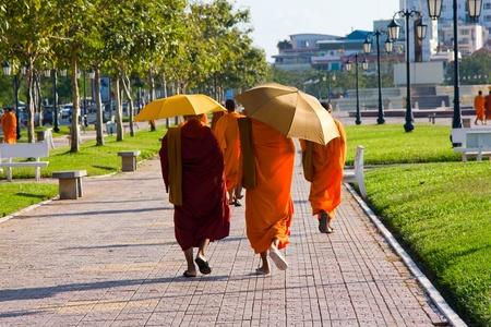 Cambodian monks walking on the street in Phnom Penh