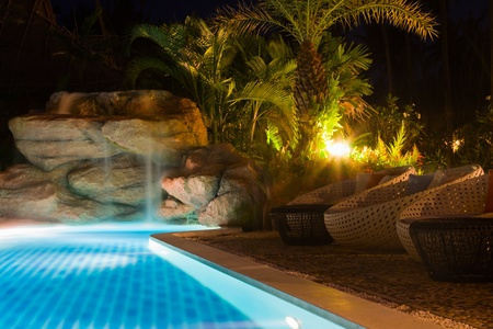 luxury resort with pool at night view photo
