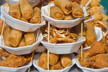 Rolls with crab meat on the market in Thailand photo