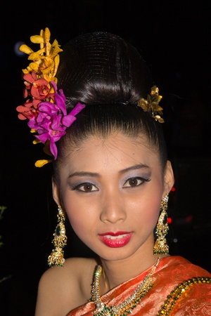 CHIANG MAI, THAILAND - NOVEMBER 10: Thai lady takes part in the opening parade of the Loy Krathong Festival in Chiang Mai, Thailand on November 10, 2011 Stock Photo - 12878255