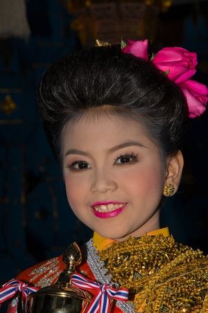 CHIANG MAI, THAILAND - NOVEMBER 10: Thai little girl takes part in the opening parade of the Loy Krathong Festival in Chiang Mai, Thailand on November 10, 2011