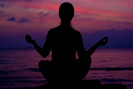 Healthy woman doing yoga outdoor, sunset over sea Stock Photo - 13057258