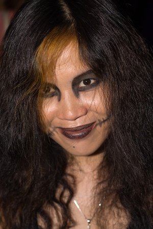 PATTAYA , THAILAND - OCTOBER 31 : Thai girl celebrates Halloween on October 31, 2011 in Pattaya, Thailand. Halloween has become popular in Thailand in recent years .