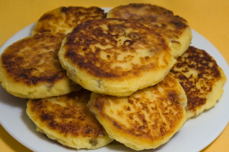 Delicious homemade cheese pancakes close-up photo