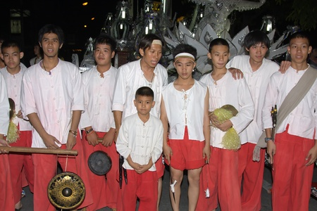 CHIANG MAI, THAILAND - NOVEMBER 11: Thai boys takes part in a parade of the Loy Krathong Festival in Chiang Mai, Thailand on November 11, 2011