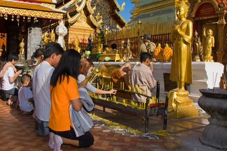 CHIANG MAI, THAILAND - NOVEMBER 11:Thai people are praying for a religious ceremony in the Doi Suthep temple during the Loy Krathong festival in Chiang Mai, Thailand on November 11, 2011