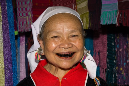 MAE HONG SON, THAILAND -NOVEMBER 12:Lahu old woman with black teeth because of chewing herbs. The Lahu tribes are a minority of Thailand surviving with opium cultivation in Mae Hong Son, Thailand on November 12, 2011 Stock Photo - 13537793